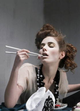 Woman using chopsticks